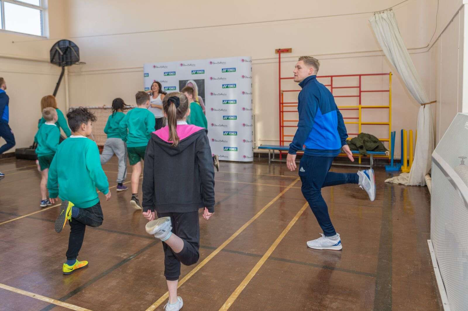Martyn Waghorn and Leoni taking part in the sports roadshow at Sidegate Primary School, Ipswich.