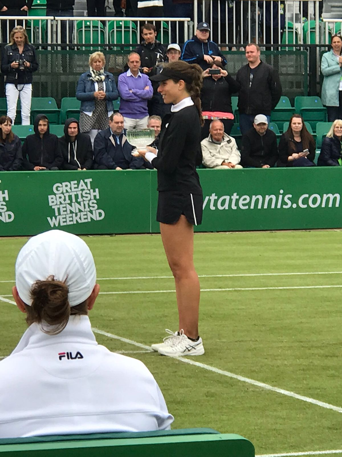 Jo Konta receiving the runners-up trophy at the Nature Valley Open in Nottingham.